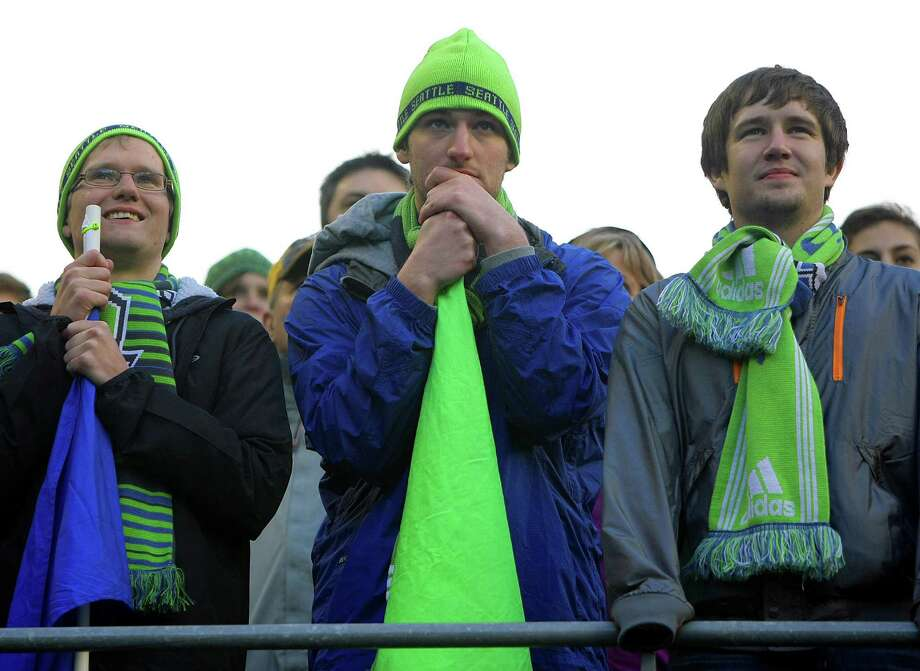 Sounders fans eagerly anticipate a ref's call during the first half of a game Saturday, March 16, 2013, at CenturyLink Field in Seattle. Photo: JORDAN STEAD / SEATTLEPI.COM