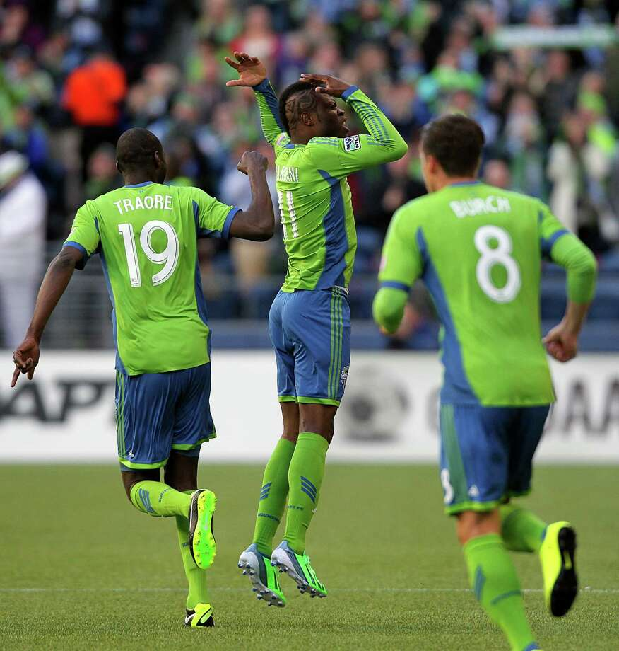 Steve Zakuani, center, rejoices with teammates after scoring the only goal of the first half against the Portland Timbers during a game Saturday, March 16, 2013, at CenturyLink Field in Seattle. Photo: JORDAN STEAD / SEATTLEPI.COM