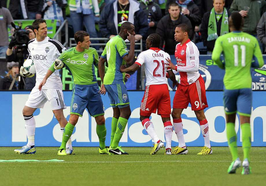 Sounders and Timbers players verbally clash after a collision between players at the Sounders' goal net during the first half of a game Saturday, March 16, 2013, at CenturyLink Field in Seattle. Photo: JORDAN STEAD / SEATTLEPI.COM