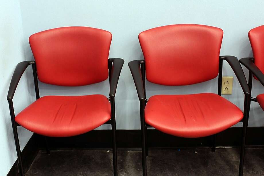 Waiting at Walgreens  - The chairs at Walgreens are actually quite comfortable and festive. Photo: Eve Jordan