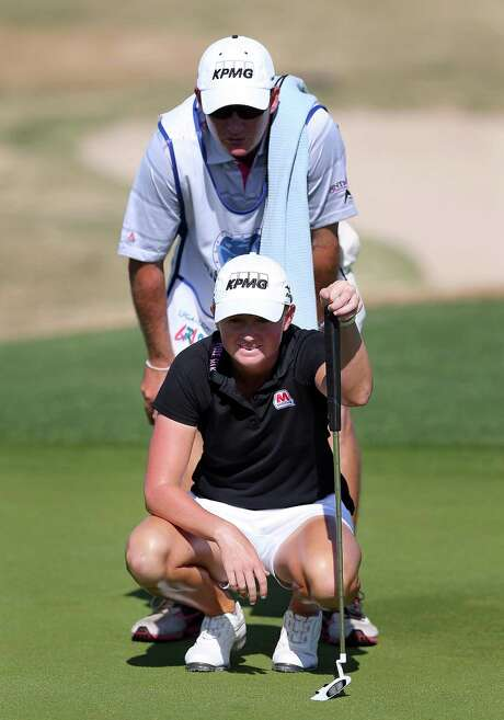 Stacy Lewis surveys the 15th with Travis Wilson, one hole before his error cost her two shots. Photo: Christian Petersen / Getty Images