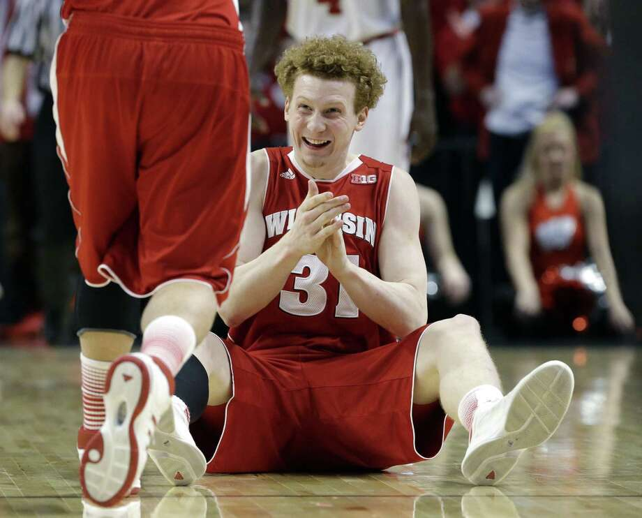 Wisconsin's Mike Bruesewitz shows his pleasure at a referee's call in the second half of Saturday's Big Ten semifinal game. The Badgers won 68-56. Photo: Nam Y. Huh / Associated Press