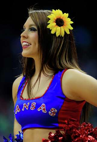 A member of the Kansas Jayhawks cheerleaders performs in the first half against the Kansas State Wildcats during the Final of the Big 12 basketball tournament at Sprint Center on March 16, 2013 in Kansas City, Missouri. Photo: Jamie Squire, Getty Images / 2013 Getty Images