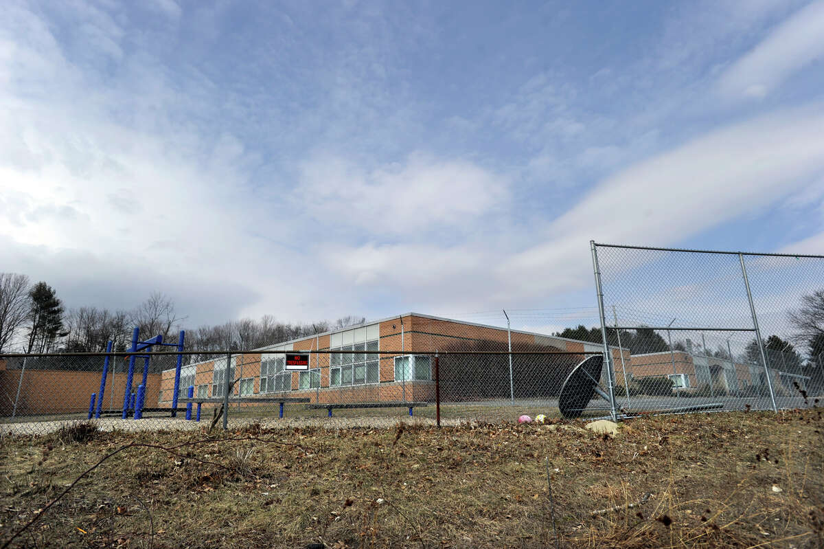 The Sandy Hook Elementary School is viewed from the playground area, Friday, March 15, 2013.