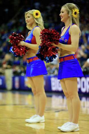 Members of the Kansas Jayhawks cheerleaders perform in the first half against the Kansas State Wildcats during the Final of the Big 12 basketball tournament at Sprint Center on March 16, 2013 in Kansas City, Missouri. Photo: Jamie Squire, Getty Images / 2013 Getty Images