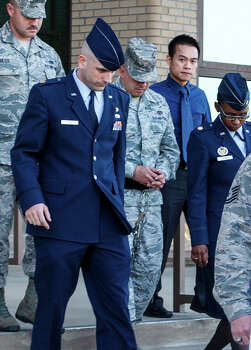 A shackled Staff Sgt. Eddy Soto (center) is escorted out of a building at Joint Base San Antonio-Lackland after being found guilty. Photo: MARVIN PFEIFFER, Express-News / Express-News 2013