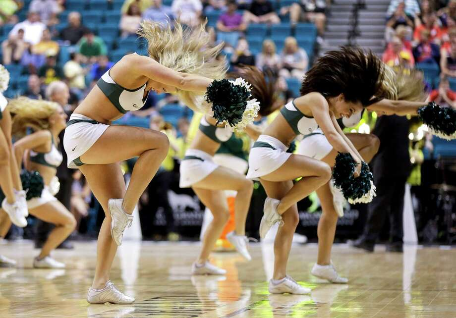 Oregon cheerleaders perform during a timeout during a Pac-12 tournament NCAA college basketball game against Washington, Thursday, March 14, 2013, in Las Vegas. (AP Photo/Julie Jacobson) Photo: Julie Jacobson, Associated Press / AP