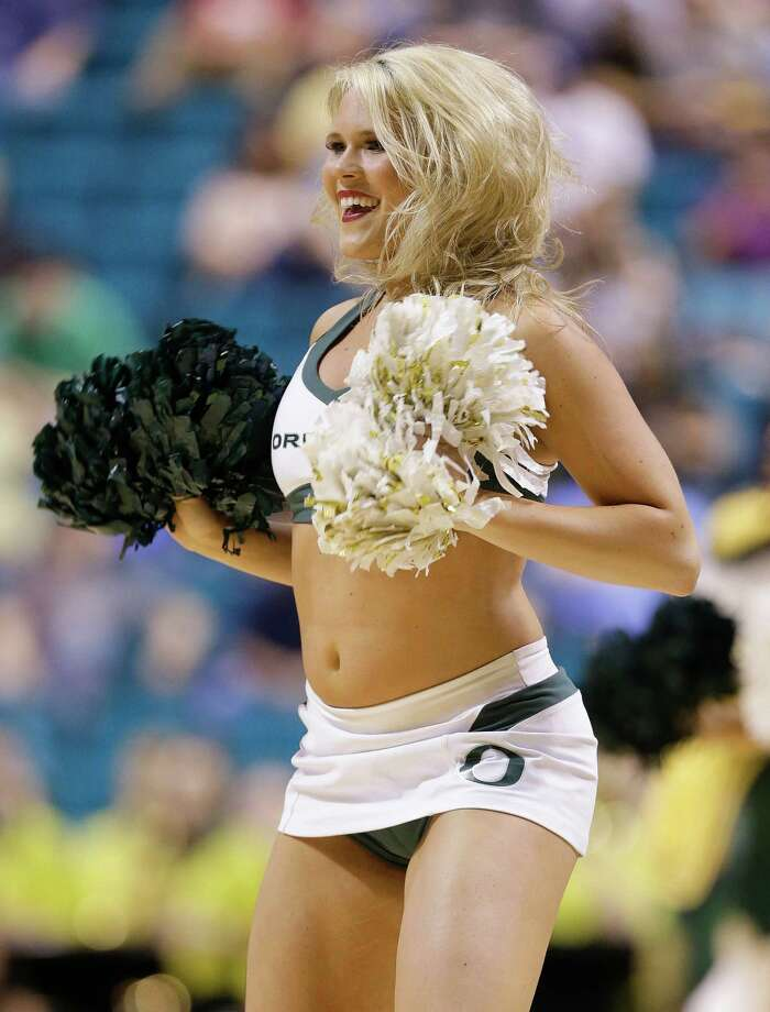An Oregon cheerleader performs during timeout against Washington during a Pac-12 tournament NCAA college basketball game, Thursday, March 14, 2013, in Las Vegas. (AP Photo/Julie Jacobson) Photo: Julie Jacobson, Associated Press / AP