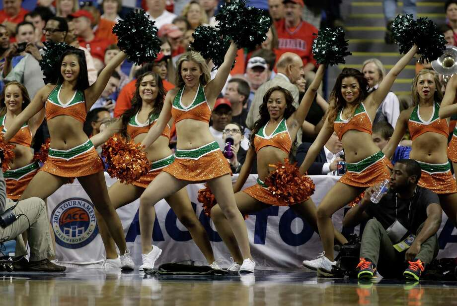 Miami cheerleaders perform during the first half of an NCAA college basketball game against North Carolina State in the semifinals of the Atlantic Coast Conference tournament in Greensboro, N.C., Saturday, March 16, 2013. (AP Photo/Bob Leverone) Photo: Bob Leverone, Associated Press / FR170480 AP