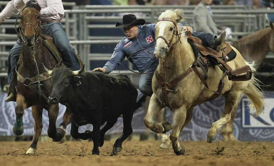K.C. Jones wrestles a steer to win the Steer Wrestling competition during the final BP Super Series