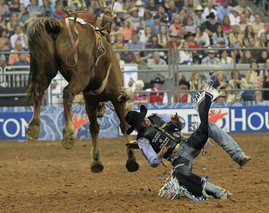 Jesse Wright gets bucked off the horse during the Saddle Bronc Riding event before the Championship round at the Houston Livestock Show and Rodeo Saturday, March 16, 2013, in Houston. Photo: Karen Warren, Houston Chronicle / © 2013 Houston Chronicle