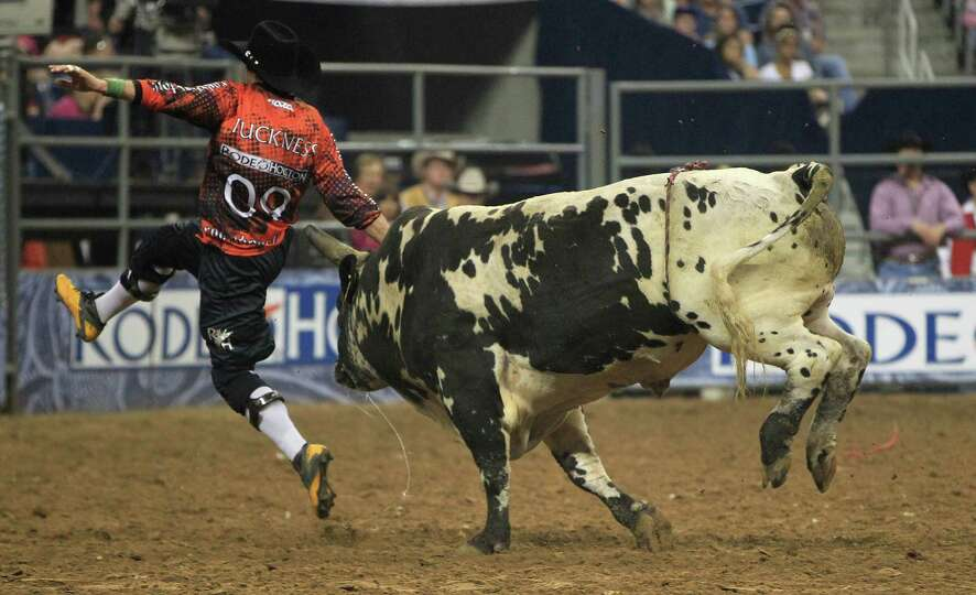 Bullfighter Dusty Tuckness gets chased by a bull after a ride during the Bull Riding event before th