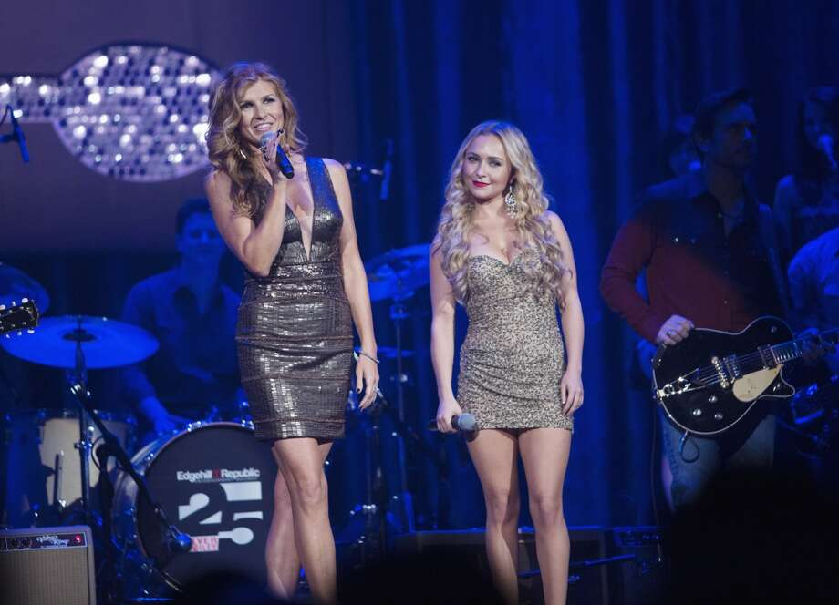 Connie Britton, left, performs as ''Nashville'' singer Rayna James, next to Hayden Panettiere's character Juliette, right.