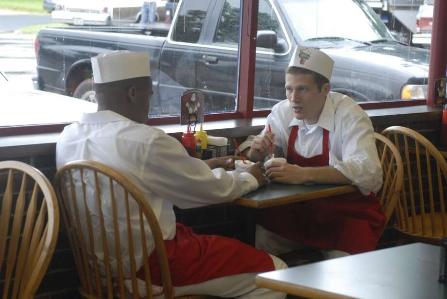 OK, FNL fans, what was the name of the fast food place where Smash (Gaius Charles, left) and Matt (Zach Gilford) worked?