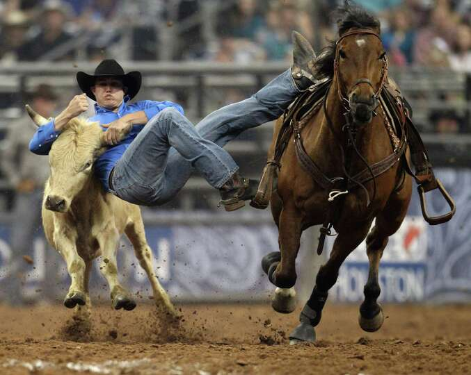 Tyler Waguespack wrestles a steer during the Steer Wrestling competition  at the Houston Livestock S
