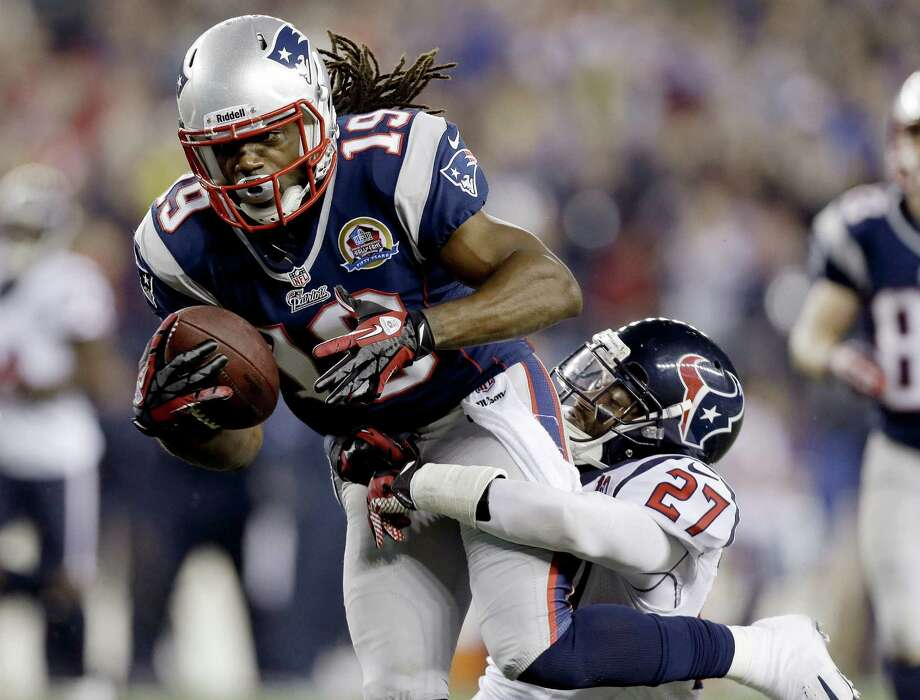 FILE - In this Dec. 10, 2012, file photo, New England Patriots wide receiver Donte' Stallworth (19) dives into the end zone for a touchdown while dragging Houston Texans defensive back Quintin Demps, right, during the third quarter of an NFL football game in Foxborough, Mass. Stallworth, a free agent, was hospitalized Saturday, March 16, 2013, with serious burns after the hot air balloon carrying him and two other people crashed into power lines above South Florida, his agent, Drew Rosenhaus, said. (AP Photo/Elise Amendola, File) Photo: Elise Amendola