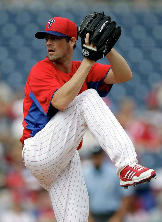 "FILE - In this Feb. 23, 2013, file photo, Philadelphia Phillies pitcher Cole Hamels delivers against the Houston Astros during an exhibition spring training baseball game in Clearwater, Fla. Hamels says it's an ""honor"" to start on opening day and he'll ""cherish"" his first assignment when the Phillies begin the season against the Braves at Atlanta on April 1. (AP Photo/Matt Slocum, File) Photo: Matt Slocum"