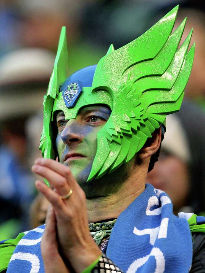Sounders fans - many dressed in the iconic blue and green color scheme - enjoy the second half of a game against the Portland Timbers Saturday, March 16, 2013, at CenturyLink Field in Seattle. Photo: JORDAN STEAD / SEATTLEPI.COM