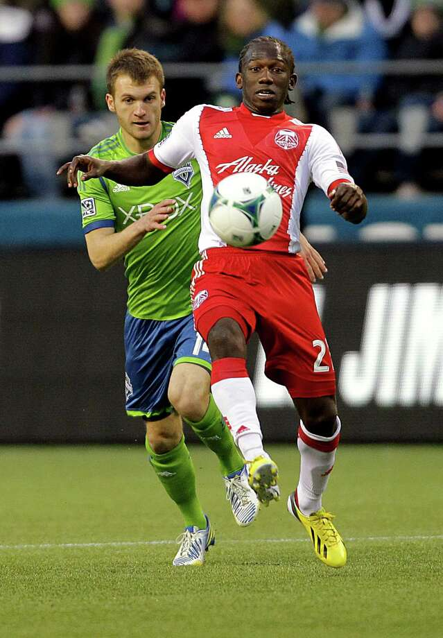 Portland Timbers midfielder Diego Chara, foreground, is chased by Seattle Sounder Alex Caskey, background, during the second half of a game Saturday, March 16, 2013, at CenturyLink Field in Seattle. The Seattle Sounders and the Portland Timbers tied with a final score of 1-1. Photo: JORDAN STEAD / SEATTLEPI.COM