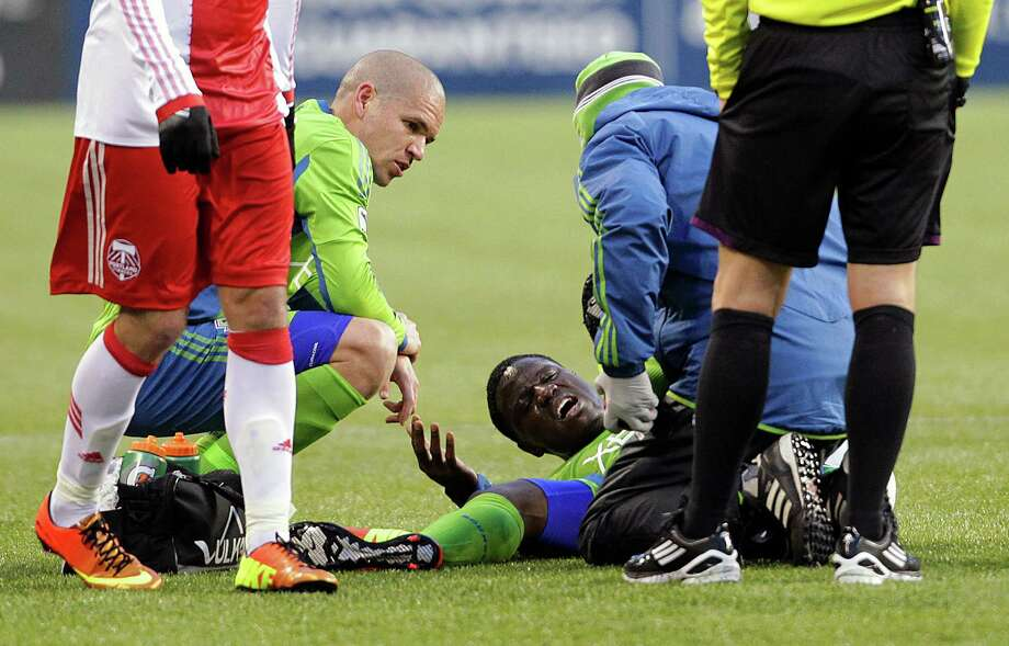 Seattle Sounders forward Eddie Johnson, center, cries out in pain after being injured during the second half of a game against the Portland Timbers Saturday, March 16, 2013, at CenturyLink Field in Seattle. The Seattle Sounders and the Portland Timbers tied with a final score of 1-1. Photo: JORDAN STEAD / SEATTLEPI.COM