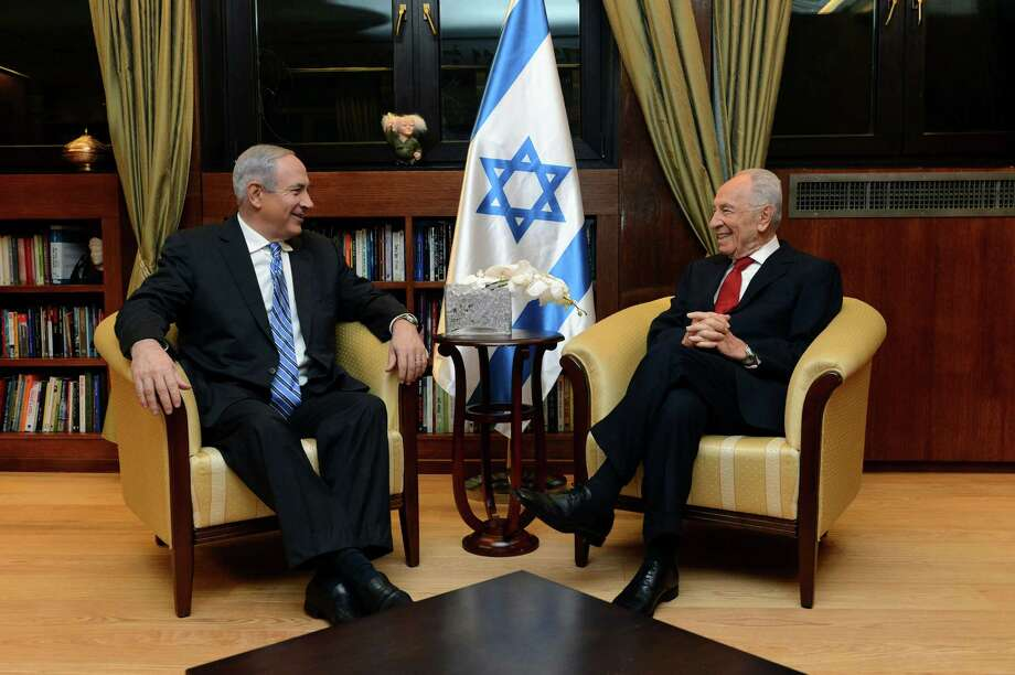 In this photograph released by the Israeli government, Israel's President Shimon Peres meets Prime Minister Benjamin Netanyahu at his office in Jerusalem, Saturday, March 16, 2013. Israel's prime minister has notified the country's president that he has succeeded in forming a government. Benjamin Netanyahu presented the lineup to President Shimon Peres on Saturday, a day after a coalition deal was signed ending weeks of deadlock. (AP Photo/Kobi Gideon, GPO) Photo: Kobi Gideon