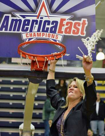 UAlbany head coach Katie Abrahamson-Henderson cuts down the net after defeating Hartford for the America East championship in Albany Saturday March 16, 2013.  (John Carl D'Annibale / Times Union) Photo: John Carl D'Annibale / 00021515A