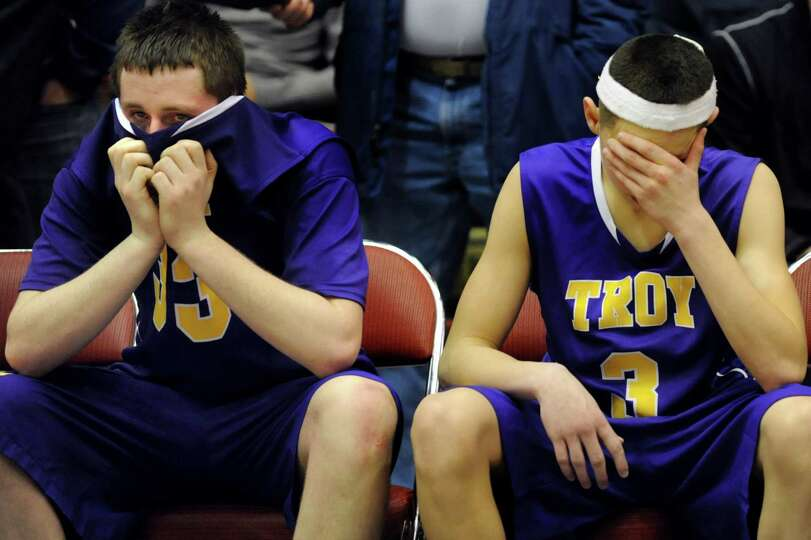 Troy's Liam Testo, left, and Zach Radz react to their 65-58 overtime loss to Bishop Kearney in their