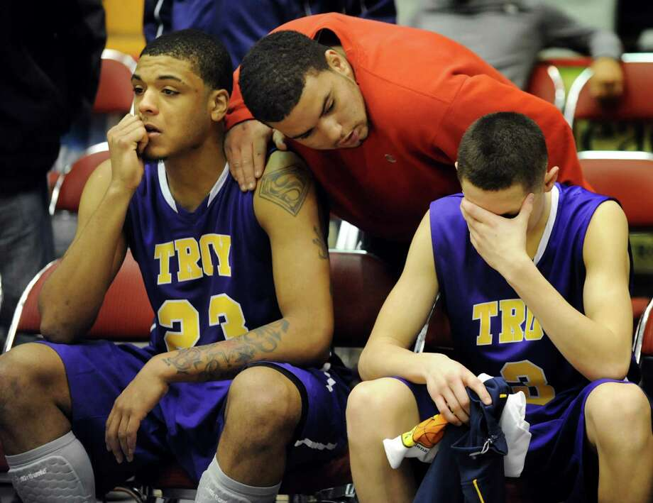 Troy's Jerrell Reid, left, and Zach Radz, right, can not be consoled after their 65-58 overtime loss to Bishop Kearney in their Class AA semifinal basketball game on Saturday, March 16, 2013, at Glens Falls Civic Center in Glens Falls , N.Y. (Cindy Schultz / Times Union) Photo: Cindy Schultz / 10021545A