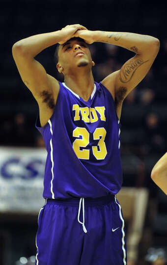 Troy's Jerrell Reid reacts when he fouls out in the second half of their Class AA semifinal basketba