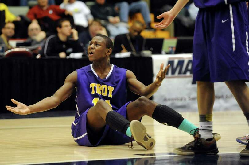 Troy's Dyaire Holt reacts when the official doesn't call a foul on Bishop Kearney during their Class