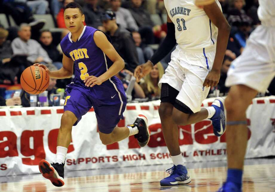 Troy's Jordan Nelson, left, drives up court during their Class AA semifinal basketball game against Bishop Kearney on Saturday, March 16, 2013, at Glens Falls Civic Center in Glens Falls , N.Y. (Cindy Schultz / Times Union) Photo: Cindy Schultz / 10021545A