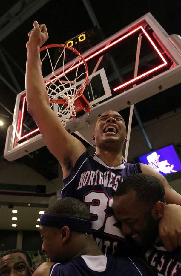 Northwestern State's DeQuan Hicks top, is carried by teammates Patriack Robinson left, and O.J. Evans right, after defeating Stephen F. Austin 68-66 in the Southland Conference basketball tournament championship game at the Leonard E. Merrill Center Saturday, March 16, 2013, in Katy . Photo: James Nielsen, Houston Chronicle / © 2013 Houston Chronicle