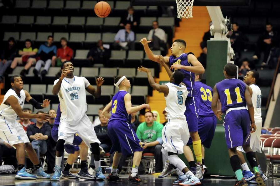 Troy's Javion Ogunyemi, top, breaks up a pass during their Class AA semifinal basketball game agains