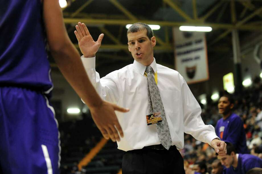 Troy's coach Richard Hurley, center, celebrates a good call during their Class AA semifinal basketball game against Bishop Kearney on Saturday, March 16, 2013, at Glens Falls Civic Center in Glens Falls , N.Y. (Cindy Schultz / Times Union) Photo: Cindy Schultz / 10021545A