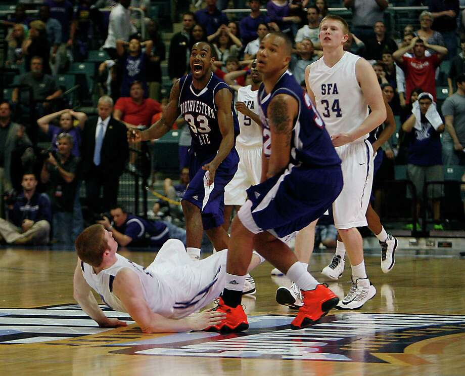 Northwestern State's James Hulbin upper left, and teammate DeQuan Hicks 2nd from right, react after defeating Stephen F. Austin 68-66 in the Southland Conference basketball tournament championship game at the Leonard E. Merrill Center Saturday, March 16, 2013, in Katy . Photo: James Nielsen, Houston Chronicle / © 2013 Houston Chronicle