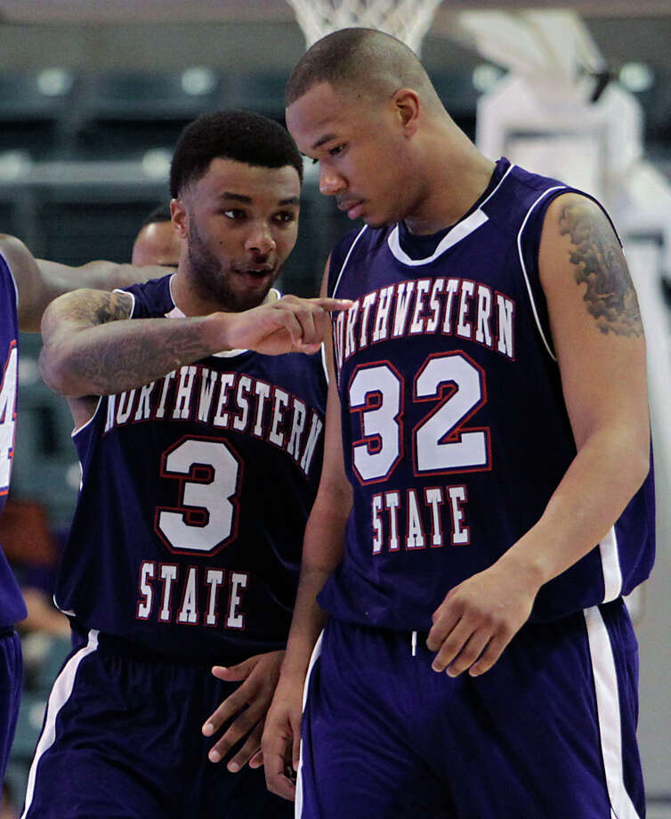 Northwestern State's Shamir Davis left, and DeQuan Hicks right, chat during second half of the Southland Conference basketball tournament championship game against Stephen F. Austin at the Leonard E. Merrill Center Saturday, March 16, 2013, in Katy . Photo: James Nielsen, Houston Chronicle / © 2013 Houston Chronicle