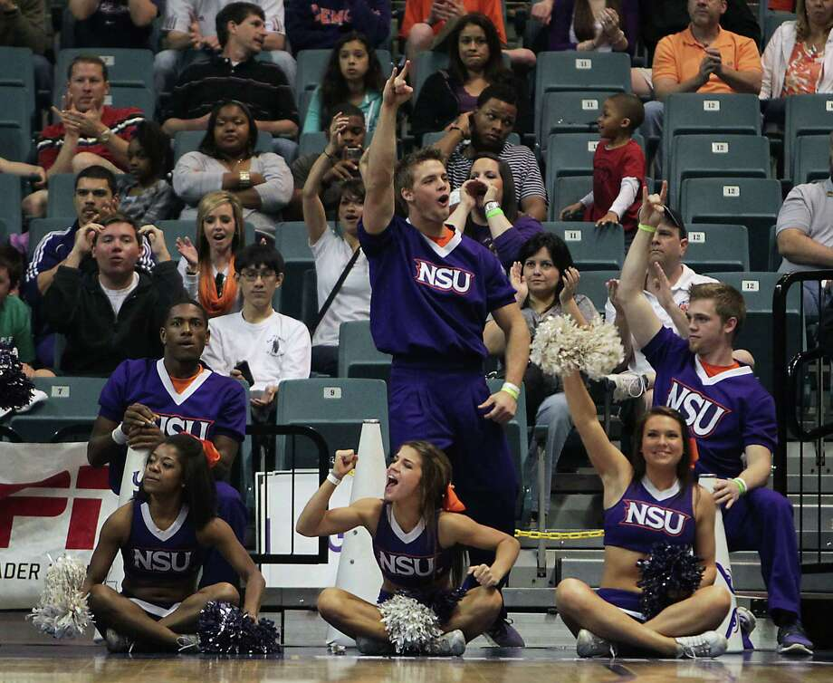 Northwestern State cheerleaders react during second half of the Southland Conference basketball tournament championship game against Stephen F. Austin at the Leonard E. Merrill Center Saturday, March 16, 2013, in Katy . Photo: James Nielsen, Houston Chronicle / © 2013 Houston Chronicle