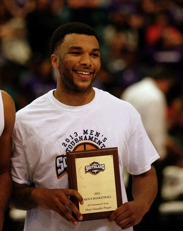 Northwestern State's Shamir Davis holds the MVP plaque after Northwestern defeated Stephen F. Austin 68-66 in the Southland Conference basketball tournament championship game at the Leonard E. Merrill Center Saturday, March 16, 2013, in Katy . Photo: James Nielsen, Houston Chronicle / © 2013 Houston Chronicle