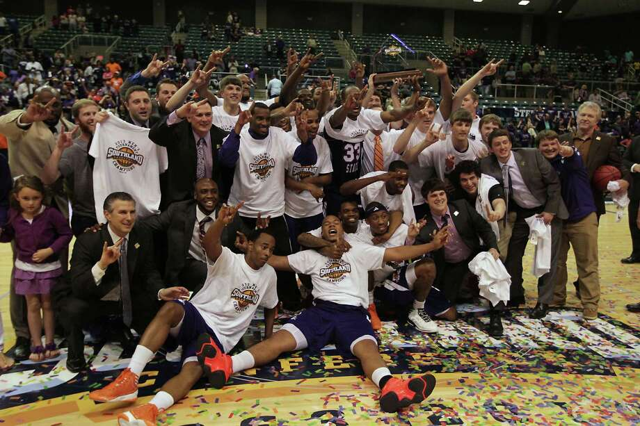 Northwestern State's players and coaches react after defeating Stephen F. Austin 68-66 in the Southland Conference basketball tournament championship game at the Leonard E. Merrill Center Saturday, March 16, 2013, in Katy . Photo: James Nielsen, Houston Chronicle / © 2013 Houston Chronicle