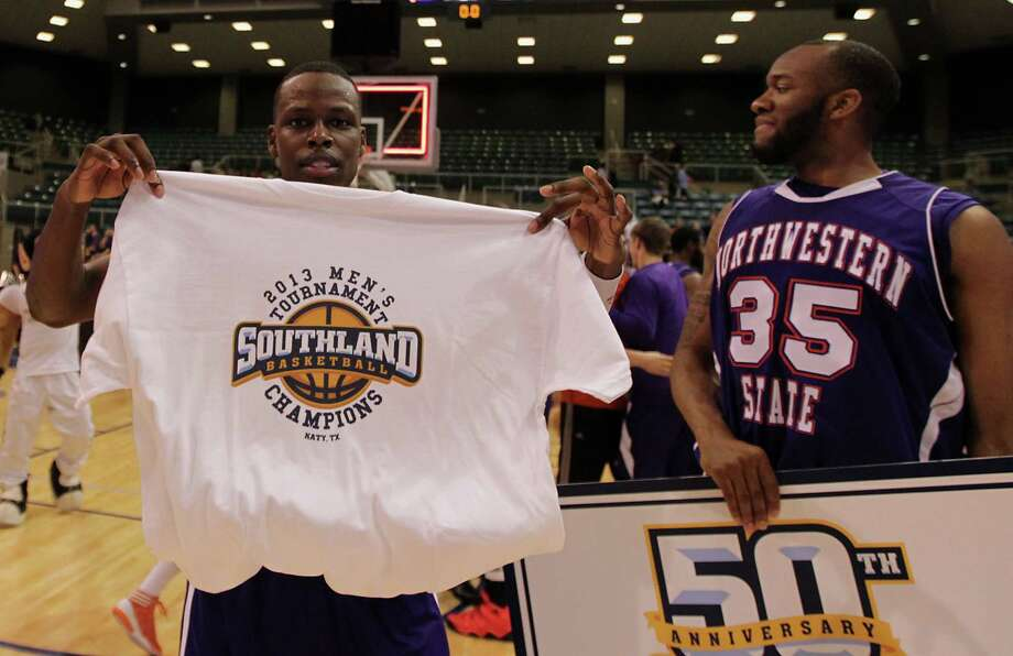 Northwestern State's Gary Stewart left, and teammate O.J. Evans right, react after defeating Stephen F. Austin 68-66 in the Southland Conference basketball tournament championship game at the Leonard E. Merrill Center Saturday, March 16, 2013, in Katy . Photo: James Nielsen, Houston Chronicle / © 2013 Houston Chronicle