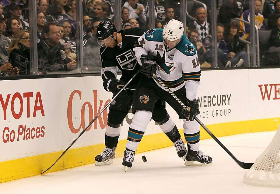 The Kings' Jeff Carter and the Sharks' Patrick Marleau vie for position behind the Kings' net in the first period. Marleau scored one of San Jose's two goals. Photo: Victor Decolongon, Getty Images