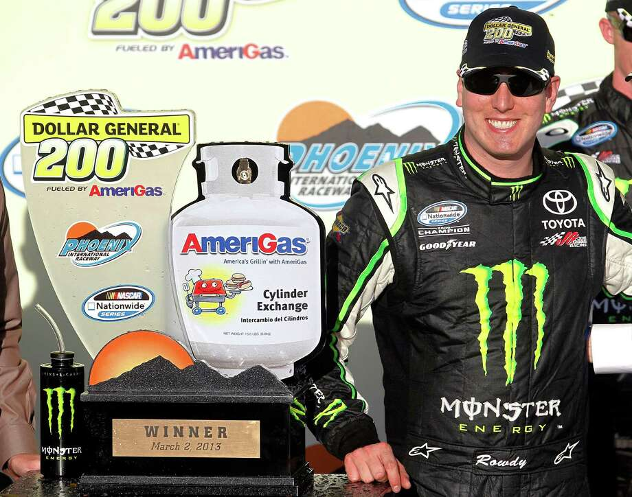 Kyle Busch poses with the trophy for photographers after winning the NASCAR Nationwide Series auto race Saturday, March 2, 2013, at Phoenix International Raceway in Avondale, Ariz.(AP Photo/Paul Connors) Photo: Paul Connors, FRE / FR5880 AP