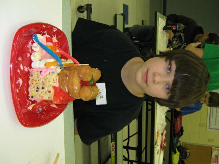 "Maple Avenue Middle School in Saratoga Springs presented its Art Night on March 14 in a choice of six workshops. Ezra Ruggles shows off his ""edible art"" (Carrie Eggleston)"