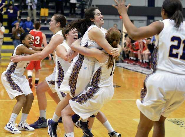 UAlbany women celebrate with after defeating Hartford  for the America East championship in Albany Saturday March 16, 2013.  (John Carl D'Annibale / Times Union) Photo: John Carl D'Annibale / 00021515A