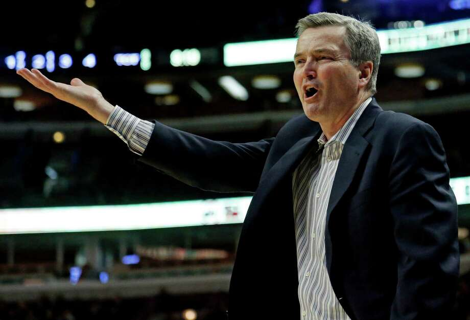 Northwestern head coach Bill Carmody reacts during the second half of an NCAA college basketball game at the Big Ten tournament against Iowa Thursday, March 14, 2013, in Chicago. (AP Photo/Charles Rex Arbogast) Photo: Charles Rex Arbogast