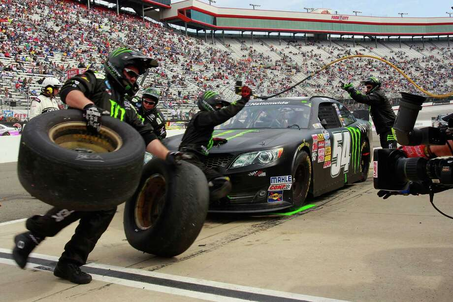 Kyle Busch's pit crew changes a tire during the Grit Chips 300 Nationwide Series race at Bristol, Tenn. Photo: Geoff Burke / Getty Images