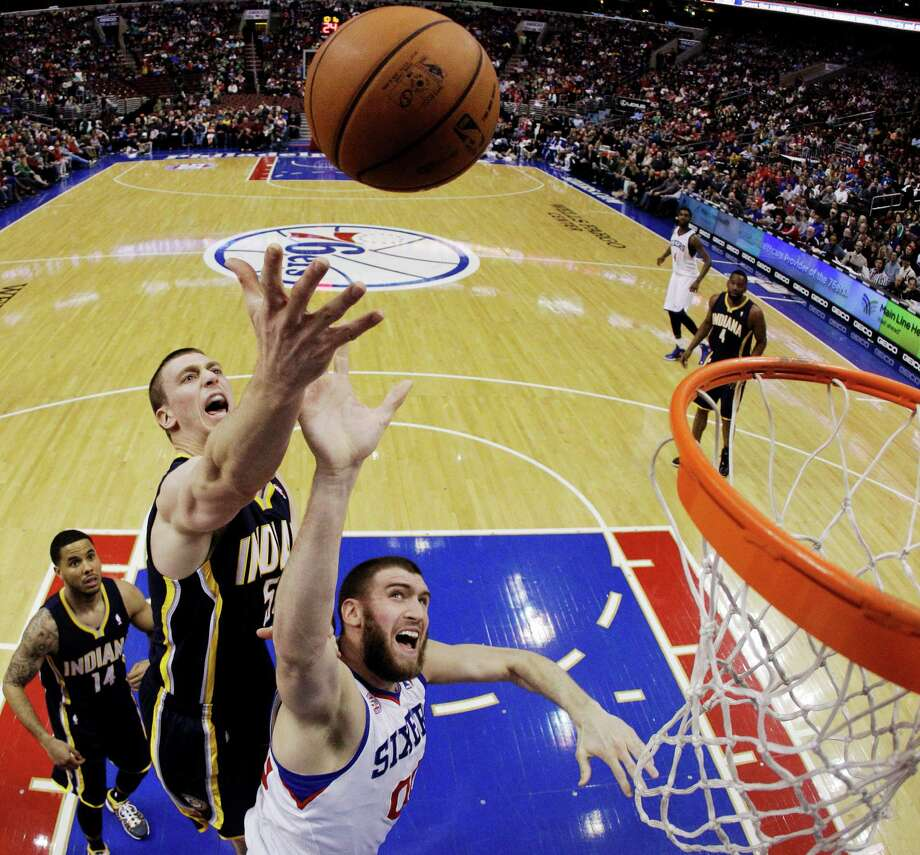 Philadelphia's Spencer Hawes, bottom center, had career bests with 16 rebounds and seven blocked shots in the 76ers' 98-91 victory over the Pacers on Saturday. Photo: Matt Slocum, STF / AP