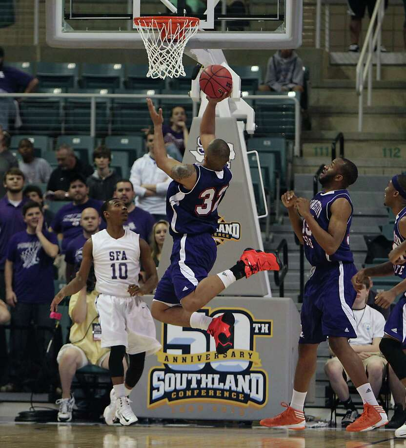 Stephen F. Austin's Trey Pinkney left, Northwestern State's DeQuan Hicks center, and Northwestern State's O.J. Evans right during first half of the Southland Conference basketball tournament championship game at the Leonard E. Merrill Center Saturday, March 16, 2013, in Katy . Photo: James Nielsen, Houston Chronicle / © 2013 Houston Chronicle