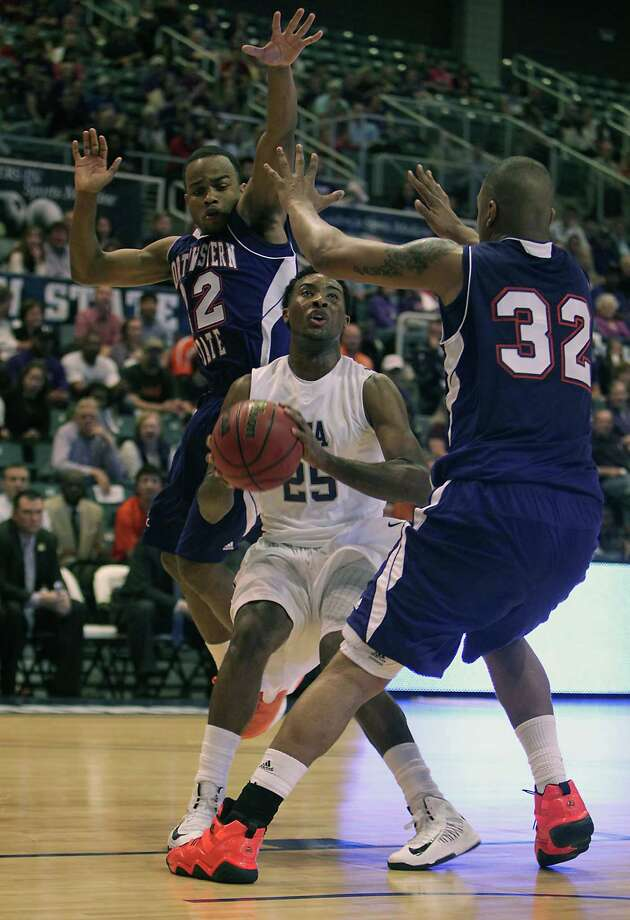 Northwestern State's Jalan West left, and DeQuan Hicks right, double-team Stephen F. Austin's Desmond Haymon center, during first half of the Southland Conference basketball tournament championship game at the Leonard E. Merrill Center Saturday, March 16, 2013, in Katy . Photo: James Nielsen, Houston Chronicle / © 2013 Houston Chronicle