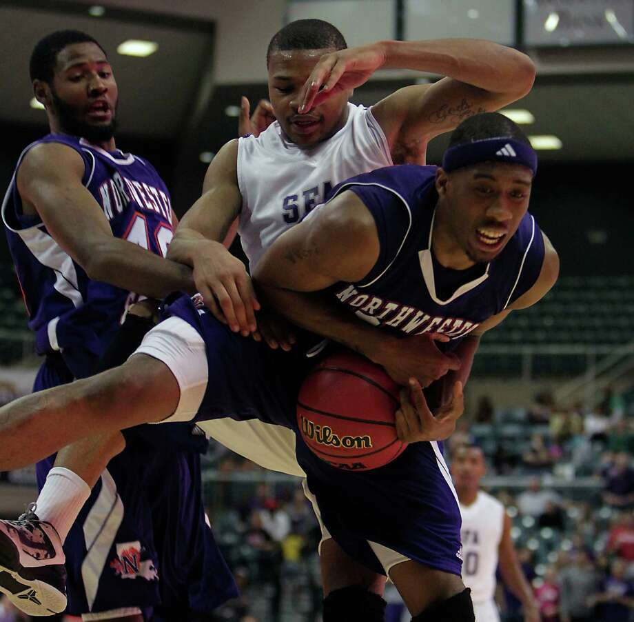 Northwestern State's Marvin Frazier left, Stephen F. Austin Taylor Smith center, and Northwestern Patrick Robinson right, chase a loose ball during first half of the Southland Conference basketball tournament championship game at the Leonard E. Merrill Center Saturday, March 16, 2013, in Katy . Photo: James Nielsen, Houston Chronicle / © 2013 Houston Chronicle